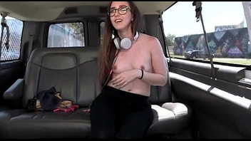Teen babe in glasses strips in the sex bus