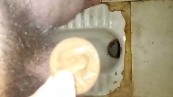 Masturbate using cock rubber in dirty broach toilet