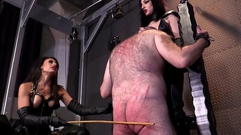 Two Femdom Mistresses cane male underling to his knees