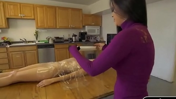Babe gets throng wrapped with cling wrapper on the table