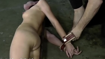 Caged honey forced to give blowjob